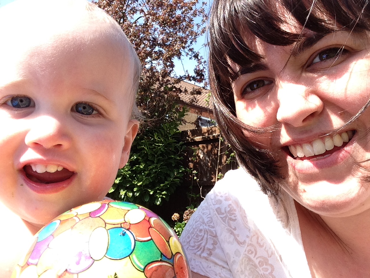 Adam and I covered in grass today by the paddling pool.